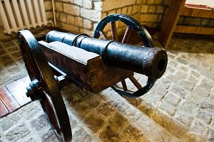 Very old cannon made of iron in muse