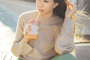 Millennial woman drinking a smoothie