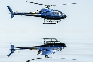Helicopter flying reflections