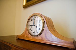 Close-up photo of clock on the woode