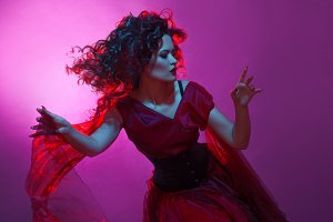 Goth girl. Woman in red dancing.