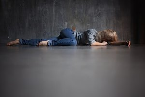 Depression. Young woman lying