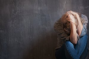 Depression, abuse. Woman sitting