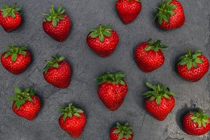 Strawberries on dark background