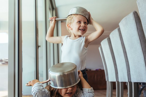 Stock Photos: Jacob Lund Photography - Children playing knight with kitchen