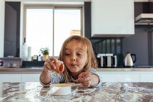Beautiful young girl baking