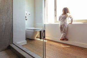 Little girl looking outside