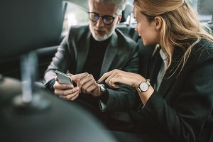 Business people using smart phone