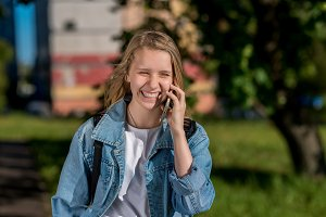 Girl schoolgirl talking on the phone