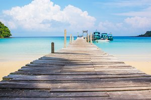 Blue sea with wooden bridge