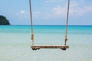 Wood swing on the beach