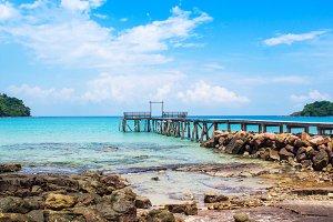 Blue sea with wooden bridge