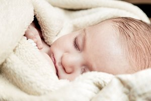 Baby sleeping covered with blanket