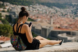 woman travel with smartphone and bac