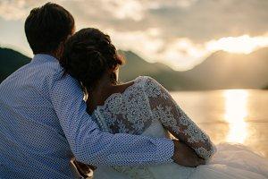 wedding couple travel at sunset