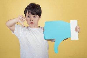 boy holding a dislike icon
