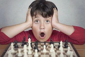 Little boy playing chess