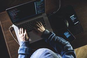 overhead hacker in the hood working