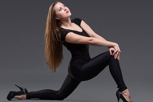 attractive young woman dancing, on a