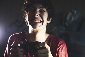 young game addicted teenager playing