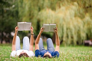 Relaxed young couple reading books w