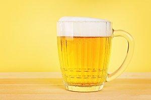 Glass beer on wood background with c