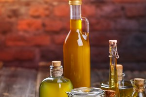 Olive oil in glass bottles and olive