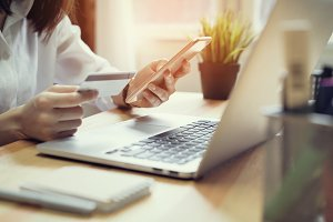 Woman holding credit card pay online