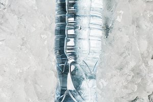 water in bottle on a background of i