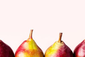 Ripe pears on pink background. Autum