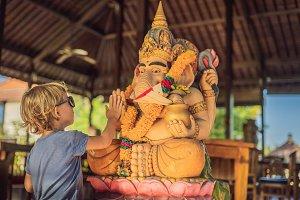 Caucasian boy high-five Ganesha