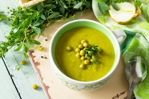 Puree soup with green pea in a bowl