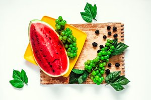 berries. red watermelon on a wooden
