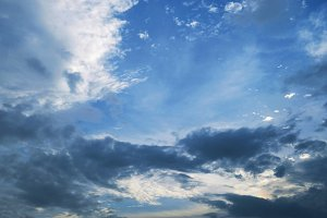 Blue sky with clouds and sunlight