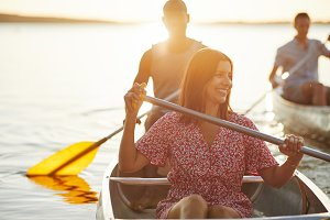 Young woman smiling while canoeing w