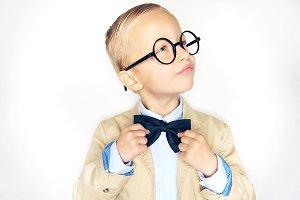 Smart little boy wearing glasses adj