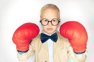 Little boy wearing a suit looking fe