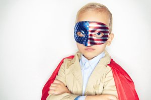 Cute little boy wearing a flag mask
