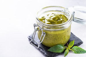 Pesto sauce in glass jar.