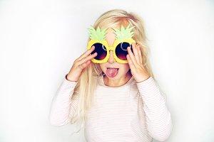 Cute little girl wearing pineapple g