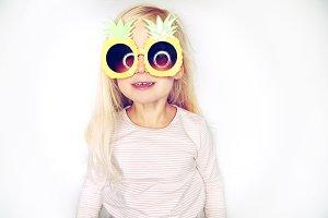 Adorable little girl wearing pineapp