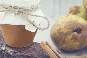 Glass jar of pear jam with cinnamon