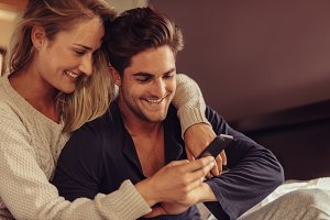 Couple looking at smart phone