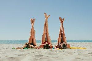 Woman in bikini sunbathing on beach