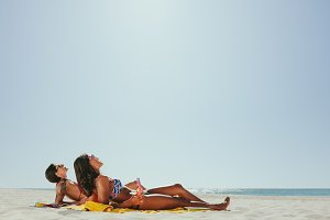 Women sunbathing on beach