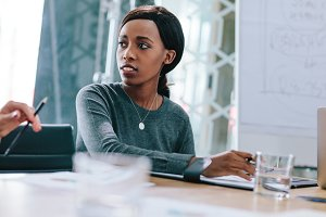 Young african woman in business