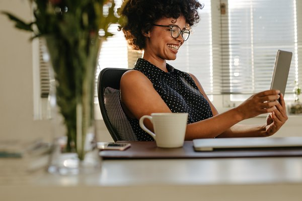 Business Stock Photos: Jacob Lund - Happy woman using digital tablet