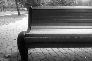 Dark black and white park bench back