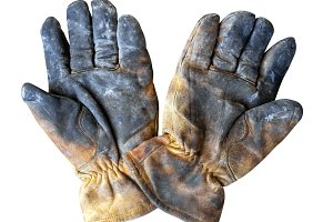 Dirty leather work gloves isolated