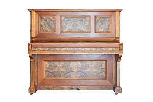 Vintage upright piano isolated